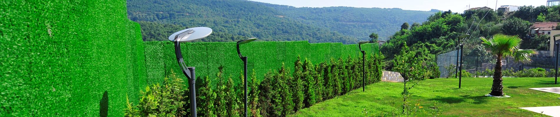 Jardines verdes y seguros con vallas de césped